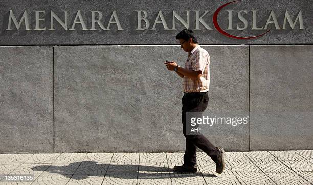 A man walks past A Malaysia islamic bank signboard in downtown Kuala Lumpur on December 9 2011Once the world's poor relation the dynamic AsiaPacific...