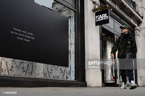A man walks past a message of tribute to late fashion designer Karl Lagerfeld at his store on Regent Street in London England on February 20 2019...