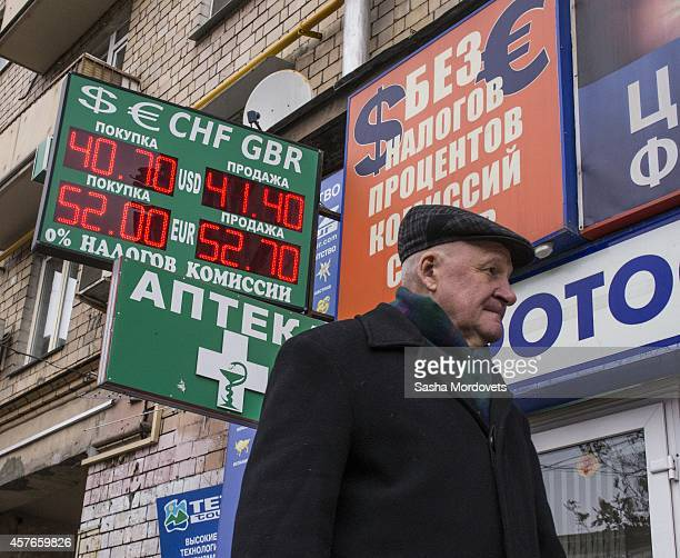A man walks past a money exchange office as it is reported that the Russian rouble has weakened on October 22 2014 in Moscow Russia Russia's currency...