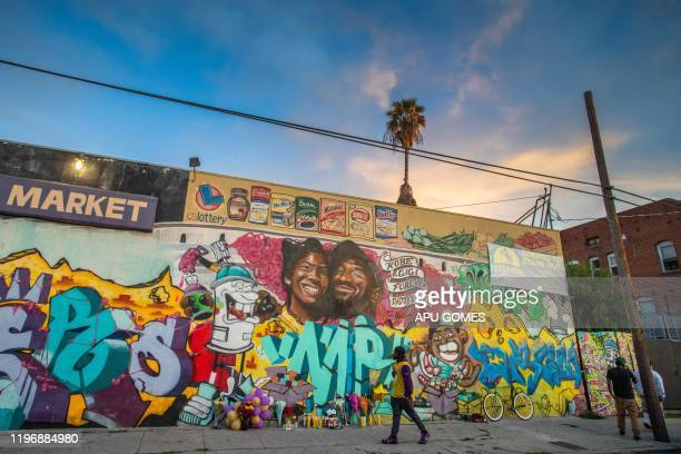 A man walks past a mural by the artists Muck Rock and Mr79lts picturing Kobe Bryant and his daughter Gianna Bryant who were killed with seven others...