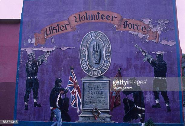 A man walks past a mural celebrating the loyalist paramilitary organization the Ulster Volunteer Force in the predominantly Protestant and loyalist...