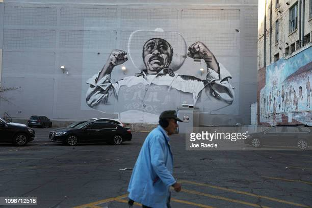 A man walks past a mural on January 19 2019 in El Paso Texas The US government is partially shutdown as President Donald Trump is asking for $57...