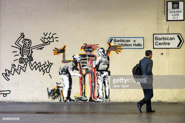 A man walks past a new work by street artist Banksy on a wall by the Barbican Centre on September 18 2017 in London England The two new Banksy murals...