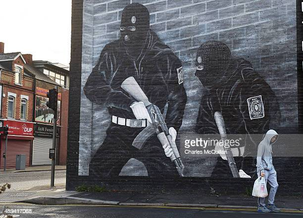 A man walks past a paramilitary mural on the Newtownards road on September 21 2015 in Belfast Northern Ireland The Northern Irish political parties...