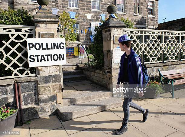 A man walks past a polling station at Sunnyfield House Community Centre on May 7 2015 in Guisborough England The nation goes to the polls today to...