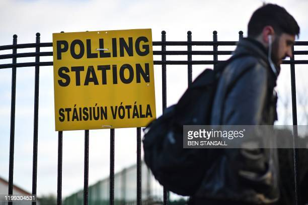 A man walks past a Polling Station in Dublin Ireland on February 8 as voting gets underway in the Irish General election Polls opened across the...