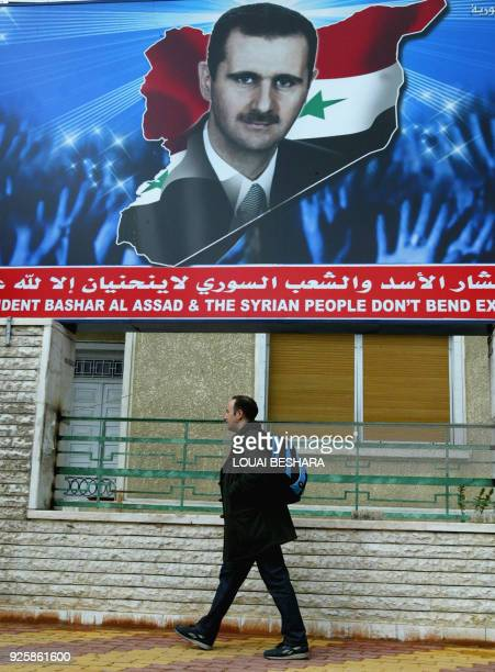 A man walks past a portrait of Syrian President Bashar alAssad in Damascus 25 April 2006 The head of the UN investigation into last year's...