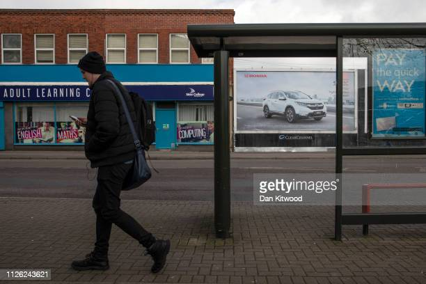 A man walks past a poster advertising Honda cars on February 20 2019 in Swindon England The car manufacturer Honda announced on Tuesday it is to shut...