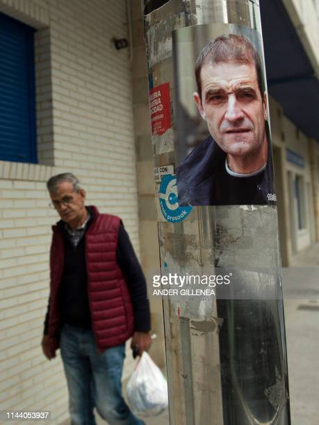 A man walks past a poster calling for the release of one of the most influential leaders of former Basque separatist group ETA Jose Antonio...