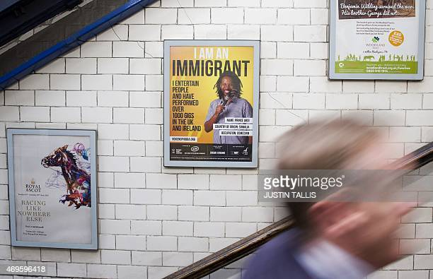 A man walks past a poster displayed as part of a campaign by The Movement Against Xenophobia at St James's Underground Station in central London on...