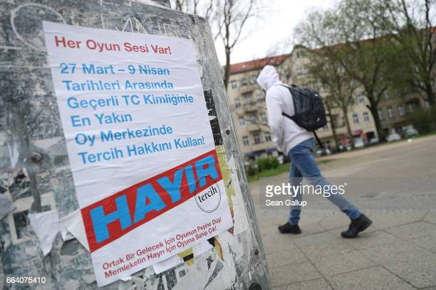 A man walks past a poster in Turkish urging 'no' in reference to the upcoming referendum in Turkey on April 3 2017 in Berlin Germany While the...