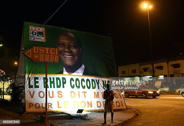 A man walks past a RHDP 's banner on October 19 2015 six day before country presidential election AFP PHOTO / ISSOUF SANOGO