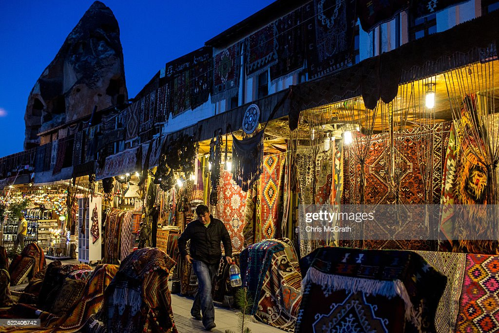 A man walks past a rug shop on April 18, 2016 in Nevsehir, Turkey. Cappadocia, a historical region in Central Anatolia dating back to 3000 B.C is one of the most famous tourist sites in Turkey. Listed as a World Heritage Site in 1985, and known for its unique volcanic landscape, fairy chimneys, large network of underground dwellings and some of the best hot air ballooning in the world, Cappadocia is preparing for peak tourist season to begin in the first week of May. Despite Turkey's tourism downturn, due to the recent terrorist attacks, internal instability and tension with Russia, local vendors expect tourist numbers to be stable mainly due to the unique activities on offer and unlike other tourist areas in Turkey such as Antalya, which is popular with Russian tourists, Cappadocia caters to the huge Asian tourist market.