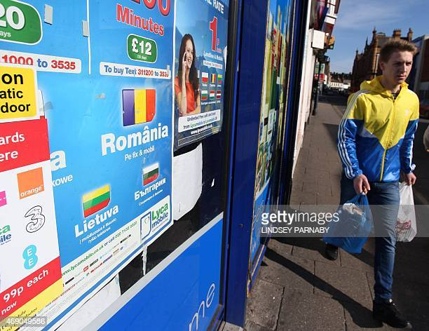 A man walks past a shop advertising cheap calls to Europe in the market town of Boston in Lincolnshire on March 5 2015 For centuries the town of...