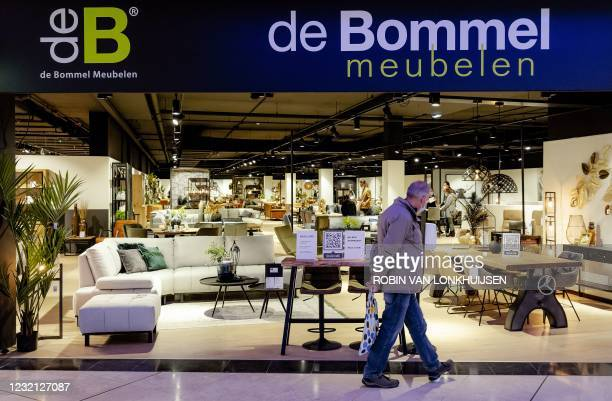 Man walks past a shop at the Woonmall Alexandrium on Easter Monday which is receiving customers by appointment and according to the guidelines of the...