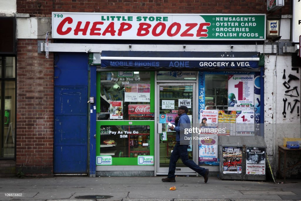 A man walks past a shop called 'Cheap Booze', in Thornton Heath on February 21, 2011 in London, England. Doctors have warned that inadequate regulations on alcohol may cost the lives of around 250,000 people in England and Wales over the next 20 years. A minimum price of 50p per unit is urgently needed, according to leading liver disease specialists.