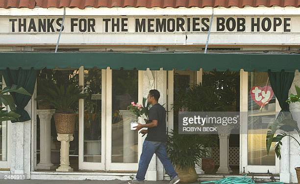 A man walks past a shop in Los Angeles where the sign marks the passing of comedian Bob Hope 28 July 2003 Bob Hope died 27 July 2003 at age 100 a...