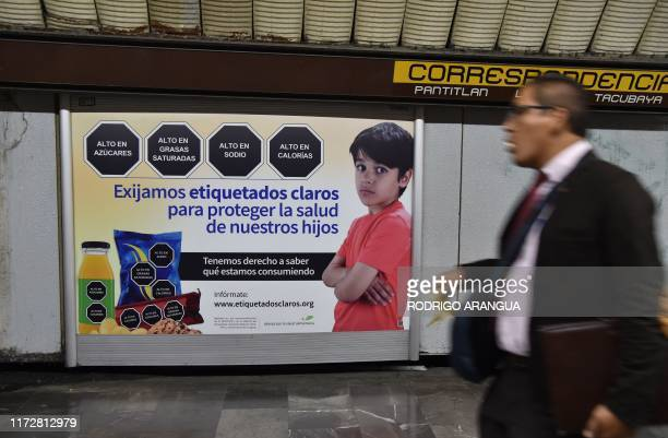 Man walks past a sign that refers to the labeling of products, in the subway of Mexico City, on October 01, 2019. - The Mexican Congress discusses...