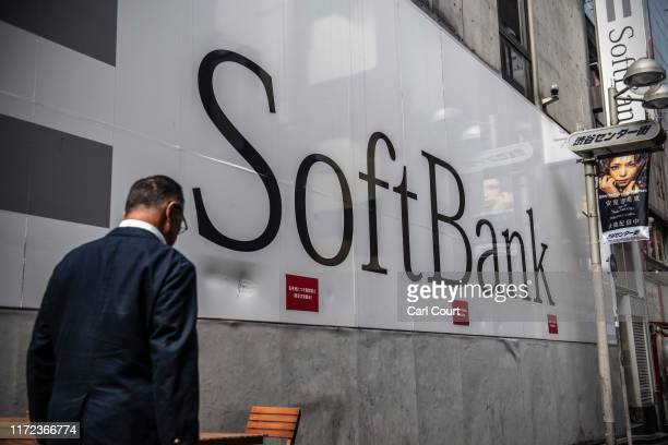 A man walks past a SoftBank mobile phone store on September 30 2019 in Tokyo Japan SoftBank the technology and investment conglomerate owned by...