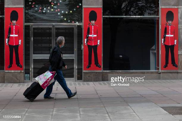 Man walks past a souvernir store on Oxford Street as shops and businesses remain closed on May 01, 2020 in London, England. British Prime Minister...
