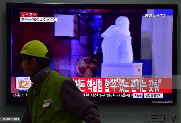 A man walks past a television display showing a news report at a railroad station in Seoul on January 6 after seismologists detected a 51 magnitude...