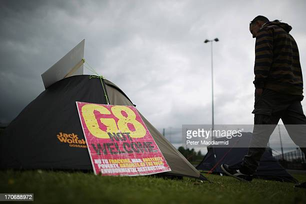 A man walks past a tent erected by an anti G8 protestor in a sports field on June 16 2013 in Enniskillen Northern Ireland The G8 group of world...