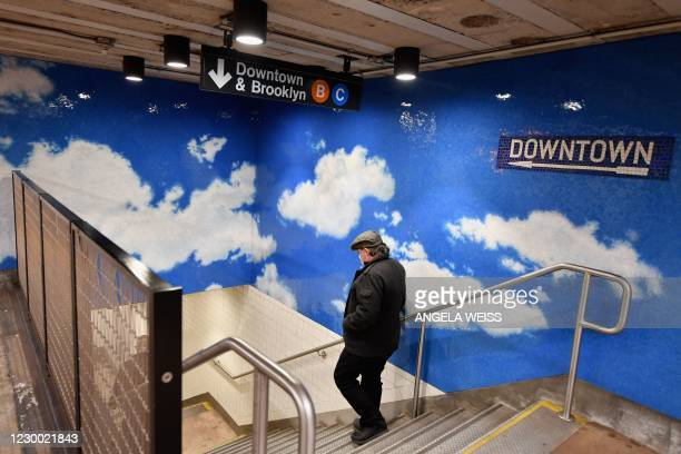 """Man walks past a tile mosaic by Yoko Ono entitled """"Sky"""" adorning the walls of the 72nd Street subway station near Central Park on the 40th..."""