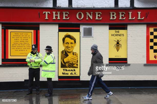 Man walks past a tribute to former England football manager Graham Taylor at 'The One Bell' ahead of his funeral at St Mary's Church on February 1,...
