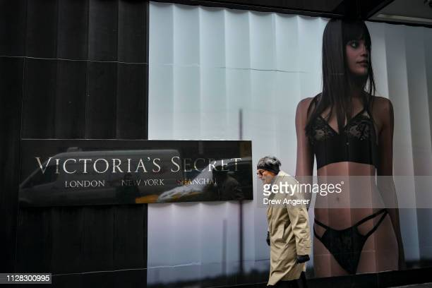 Man walks past a Victoria's Secret store in Midtown Manhattan, March 1, 2019 in New York City. Victoria's Secret is closing 53 more stores, its...