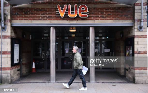Man walks past a VUE Cinema in Worcester Town Center on March 27, 2021 in Worcester, England .