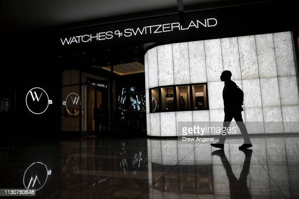 A man walks past a Watches of Switzerland store at 'The Shops' during the grand opening of phase one of the Hudson Yards development on the West Side...