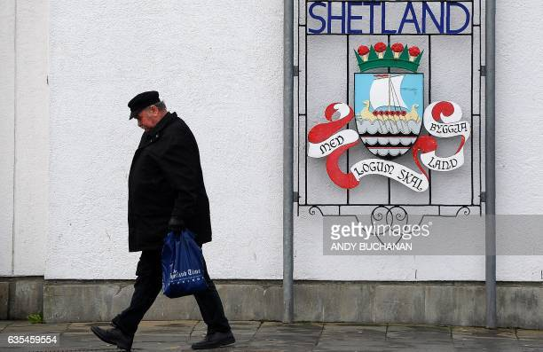 A man walks past a 'Welcome to Lerwick' sign in Lerwick Shetland Islands on February 4 2017 Of all the ramifications of the Brexit vote the fate of...