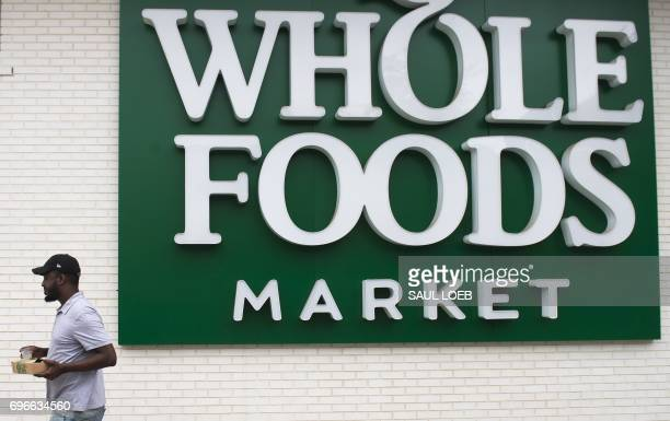 A man walks past a Whole Foods Market in Washington DC June 16 following the announcement that Amazon would purchase the supermarket chain for $137...