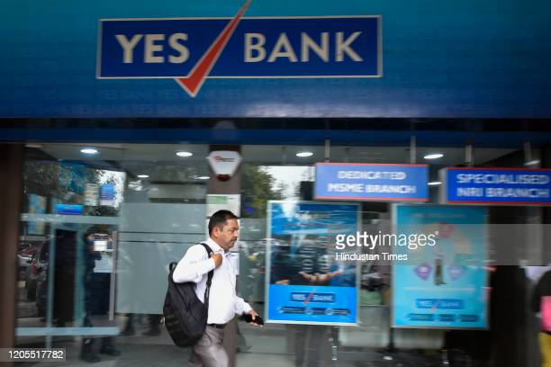 Man walks past a Yes Bank branch at Janpath, in New Delhi, India, on Friday, March 6, 2020.