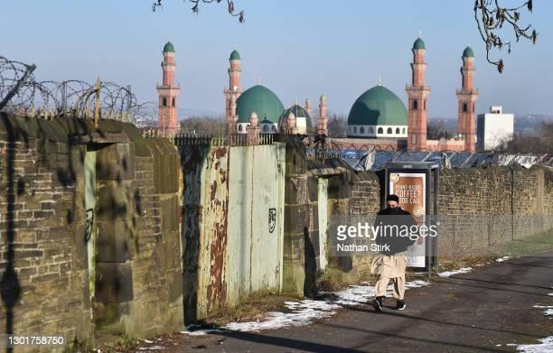 Man walks past Al-Jamia Suffa-Tul-Islam Grand Mosque on February 12, 2021 in Bradford, England.