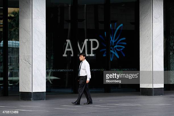 A man walks past AMP Ltd headquarters in Sydney Australia on Thursday Feb 20 2014 AMP Australias largest life insurer and fund manager rose the most...