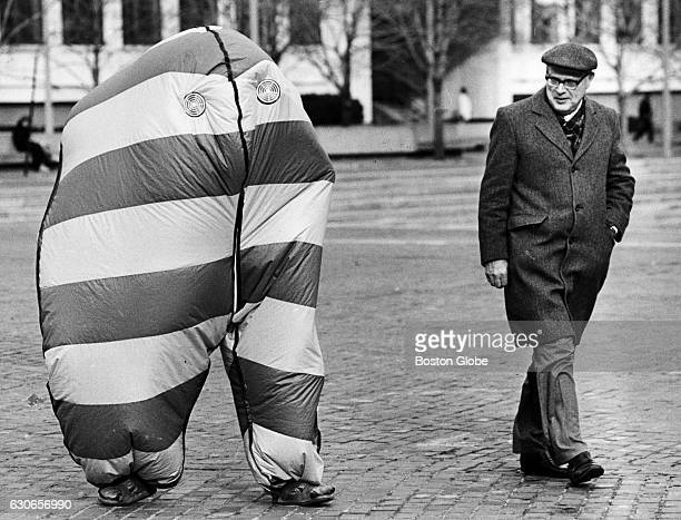 A man walks past an air bag getting ready for First Night at City Hall Plaza in Boston on Dec 31 1985