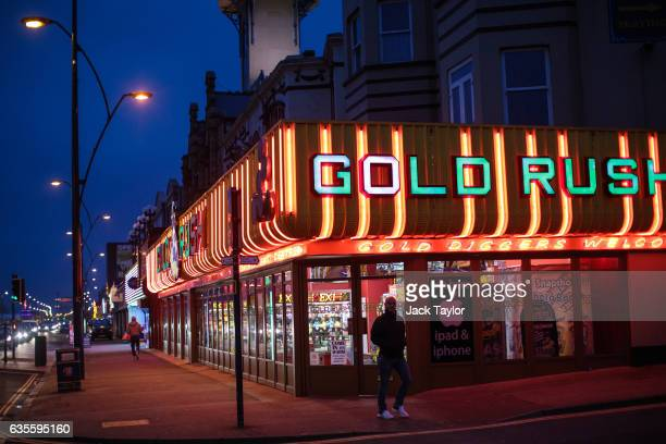 A man walks past an amusement arcade on February 8 2017 in Great Yarmouth United Kingdom The town of Great Yarmouth on the East Coast of England...