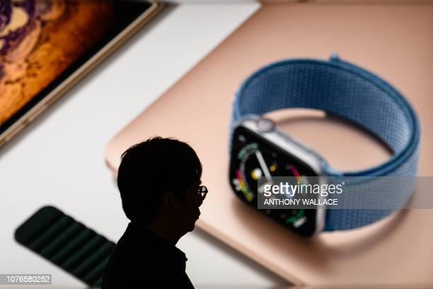 A man walks past an Apple store in Hong Kong on January 3 2019 Hong Kong stocks fell again on January 3 extending the previous day's losses as...