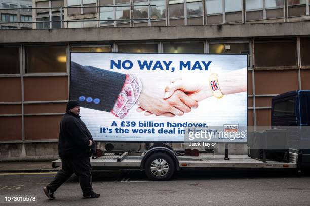 A man walks past an electronic billboard during the launch a new 'Leave Means Leave' campaign against British Prime Minister Theresa May's Brexit...