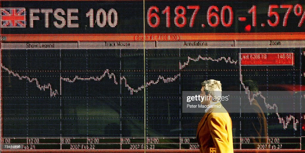 A man walks past an electronic sign displaying stock price information on February 28, 2007 in London. World stock prices have tumbled after uncertanties in the Chinese stock market.