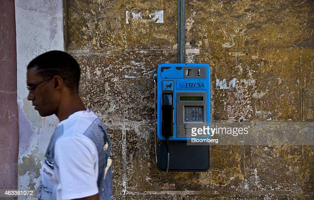 A man walks past an Empresa de Telecomunicaciones de Cuba SA public telephone in Havana Cuba on Saturday Jan 31 2015 US companies will be permitted...