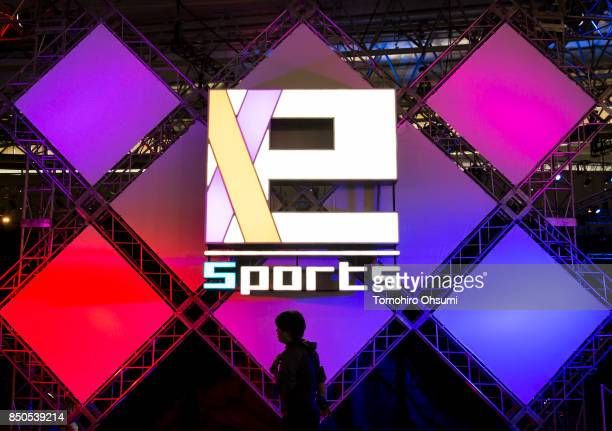 A man walks past an eSports logo during an eSports event held as part of the Tokyo Game Show 2017 at Makuhari Messe on September 21 2017 in Chiba...