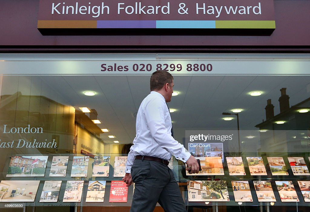 A man walks past an estate agents on December 4, 2014 in in East Dulwich, London, England. In his autumn statement, Chancellor of the Exchequer, George Osborne, cut the rate of stamp duty for lower-value house sales and raised it on those worth more than £1.5m in a move that would cut the rate of tax for 98% of house purchases.
