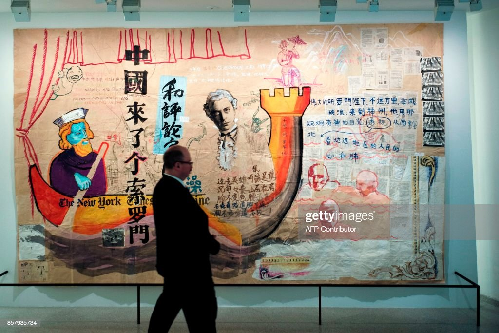 A man walks past an exhibit during the 'Art and China after 1989: Theater of the World' media preview at the Solomon R. Guggenheim Museum in New York on October 5, 2017. / AFP PHOTO / Jewel SAMAD / RESTRICTED