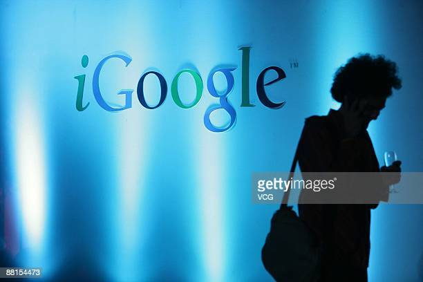 A man walks past an iGoogle sign during the iGoogle press conference held by Google China on June 1 2009 in Beijing China Google may be expanding its...