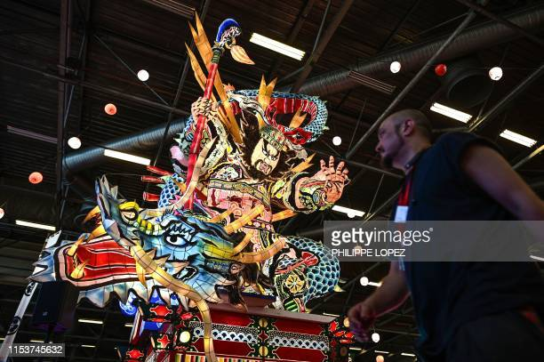 Man walks past an illuminated giant lantern at the 2019 Japan Expo exhibition in Villepinte, near Paris, on July 4, 2019. - Japan Expo, the largest...