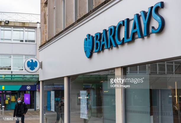 Man walks past Barclays bank logo and branch in Wales. The new, highly contagious strain of the virus has taken a firm foothold in Wales. One in four...