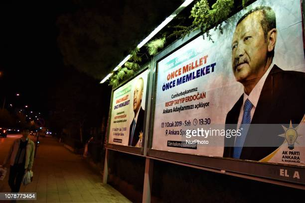 A man walks past billboards placed by the ruling Justice and Development Party picturing Turkish President Recep Tayyip Erdogan in Ankara Turkey on...