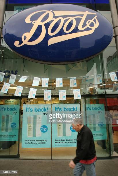 A man walks past Boots the Chemist May 4 2007 in London Boots opened four of it's larger stores at 7am to allow customers to purchase the popular...